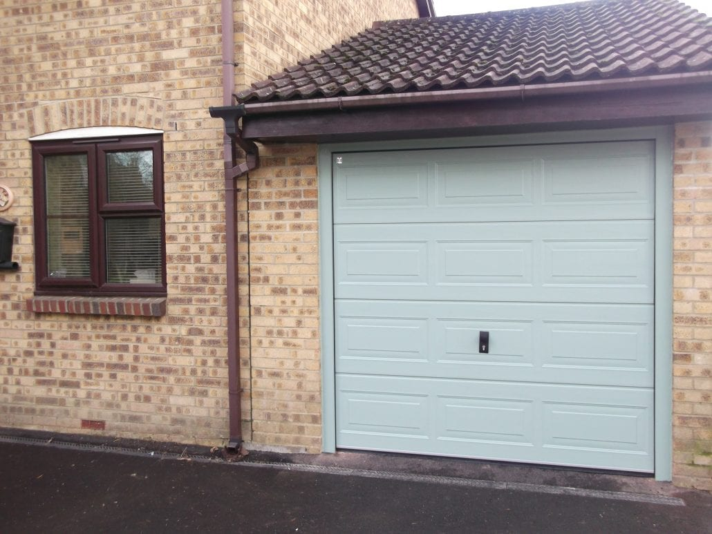 Seceuroglide insulated sectional garage door georgian cassette - Why Choose Sectional Doors