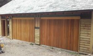Woodrite Tingewick Retractable up and over garage doors.