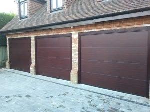 Three Garador Linear Large Premium Sectional Garage doors