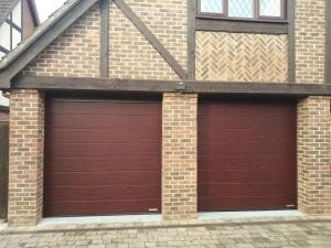 Two matching Garador Linear Medium Premium Sectional garage door