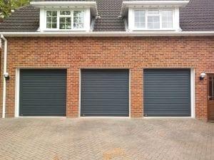 Three matching Seceuroglide Compact roller shutter garage doors
