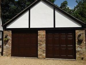 Two Wessex GRP Canterbury retractable up and over garage door