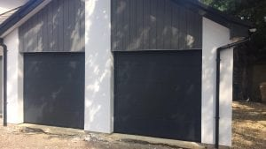 Two Allutech L ribbed sectional garage doors