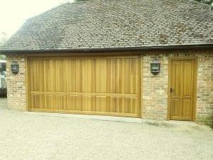 Woodrite Marston retractable up and over garage door and matching side personnel door