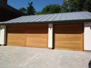 Two Woodrite Wemford Retractable up and over garage doors