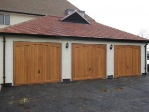 Three Woodrite Gawcott retractable up and over garage doors