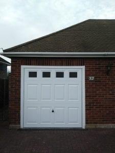 Garador Beaumont with windows canopy up and over garage door