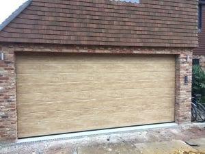 Ryterna Mid-ribbed sectional garage door