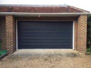 Ryterna Mid-ribbed slick sectional garage door